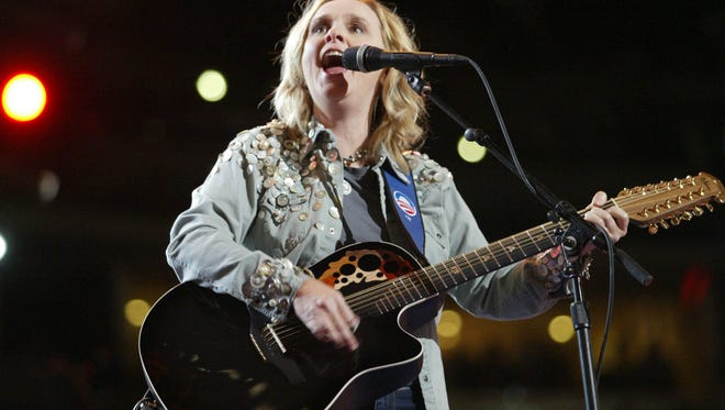 Grammy-winning singer-guitarist Melissa Etheridge performs at the Democratic National Convention at the Pepsi Center in Denver on Aug. 27, 2008.