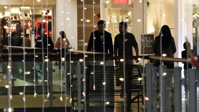 Shoppers stroll Cielo Vista Mall among holiday decorations during Black Friday in 2015.