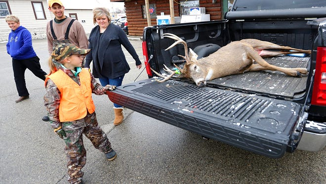 Leah Matthias, 10, of Oshkosh shows off the 10-point buck she shot about 10 minutes after the official start of the gun deer season  on Nov. 21.  The deer was shot just east of  Fond du Lac.