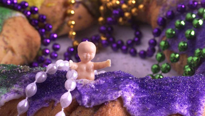 Little plastic babies are traditionally baked inside colorful King Cakes. Looking for the baby in the cake is a Mardi Gras tradition. Tradition has it that the person who gets the serving containing the baby is automatically designated the host of the next Mardi Gras party.