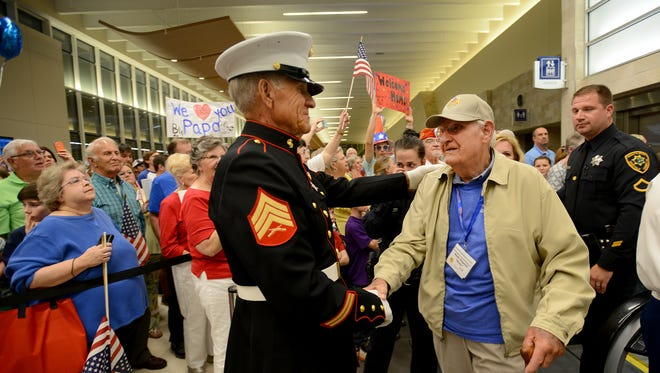 The 16th Honor Flight Upstate returned from Washington, D.C., to Greenville Spartanburg International Airport  with 85 World War II and Korean War veterans on Tuesday, April 19, 2016.