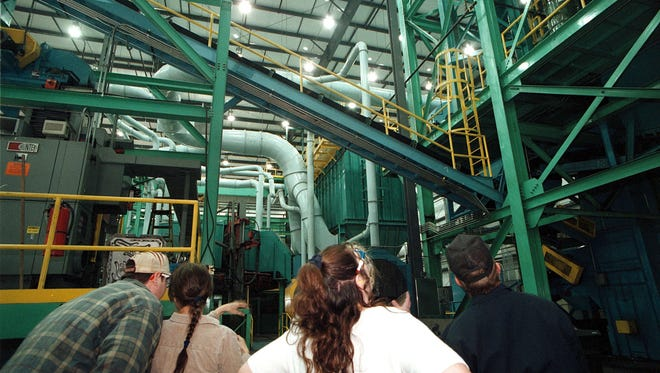 Visitors gaze up at the new foundry in action at Richmond Casting Company during an open house on April 25, 2000.