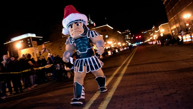 Michigan State University mascot Sparty was the Electric Light Parade's grand marshal during Friday night's Silver Bells in the City festivities.