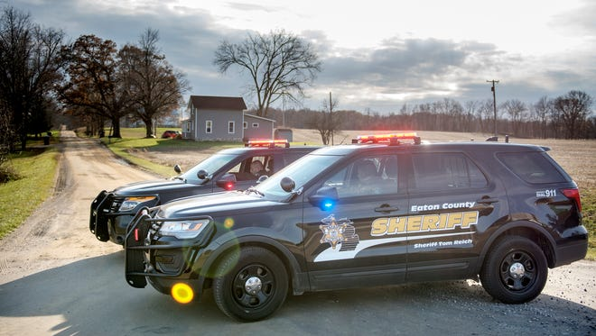 Eaton County Sheriff's Department deputies block off Boody Highway at Spicerville Highway on Tuesday, Nov. 28, 2017, in Brookfield Township west of Eaton Rapids.