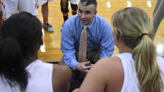 Greenfield's head girls basketball coach Willie Trevathan talks to his team during their Region 7-A Championship game, Wednesday, Feb. 28. Greenfield defeated Dresden, 66-64 in double overtime to become the Region 7-A Champions.