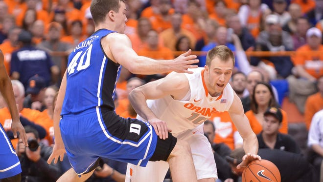 Syracuse guard Trevor Cooney (10) tries to get past Duke center Marshall Plumlee (40) during the first half of a game at the Carrier Dome last season.