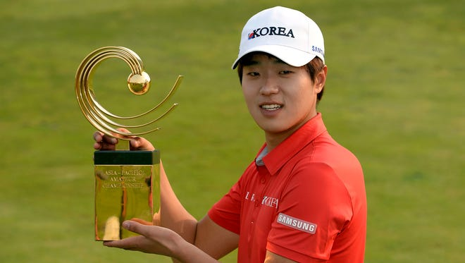 Lee Chang-woo of South Korea poses with the trophy after winning the Asia-Pacific Amateur Championship.