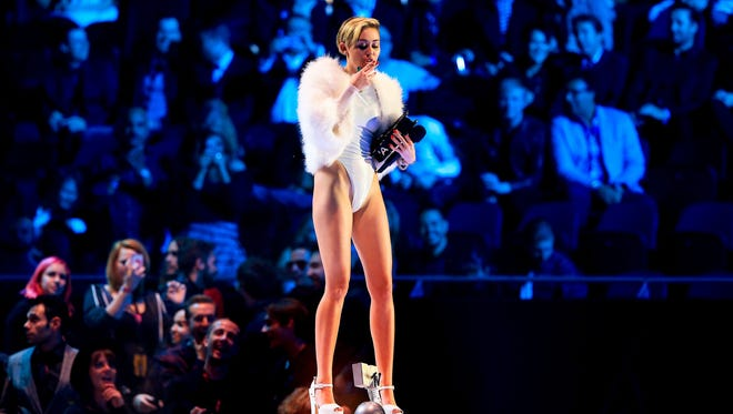Miley Cyrus smokes as she performs during the MTV Europe Music Awards in Amsterdam on Nov. 10.
