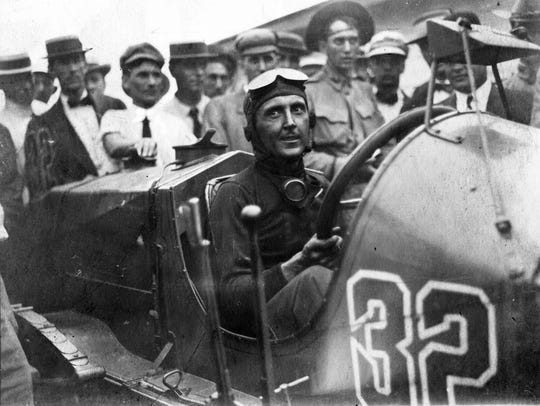 Ray Harroun sits in his Marmon Wasp after winning the