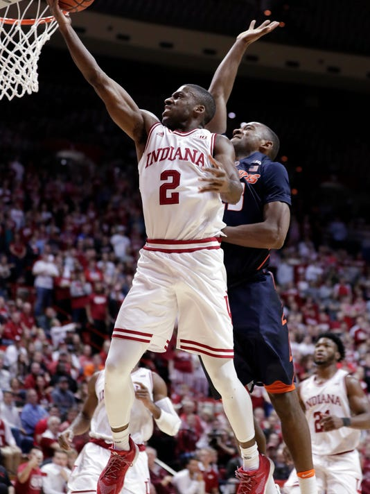 Indiana guard Josh Newkirk (2) shoots in front of Illinois guard Aaron Jordan during the second half of an NCAA college basketball game in Bloomington, Ind., Wednesday, Feb. 14, 2018. Indiana defeated Illinois 78-68. (AP Photo/Michael Conroy)