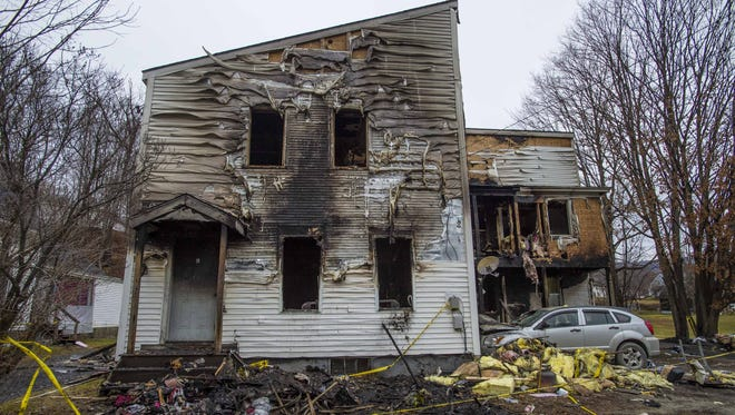 The remains of the apartment building on Union Street in Northfield where a fatal fire occurred Dec. 14, 2015.