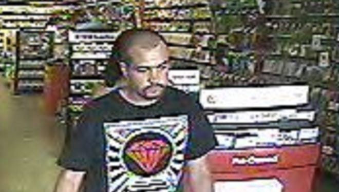 A security photo of a man accused of using stolen credit cards to make purchases at a local Game Stop and other businesses in northwest Reno.