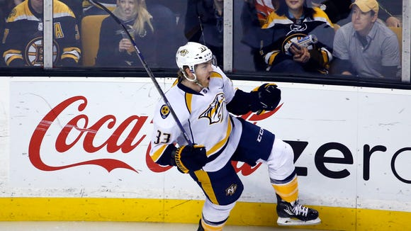 Predators center Colin Wilson (33) celebrates his goal against the Bruins in the first period.