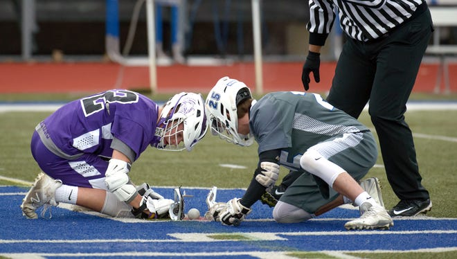 Lakeview's Jerry Haadsma (52) prepares to face off with Harper Creek's Alex Philips (25) in their matchup on April 11.