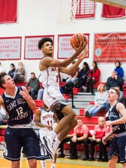 Dover's Keith Davis scores on a layup during play against
