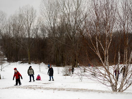 Festivalgoers try out snowshoes while attending the