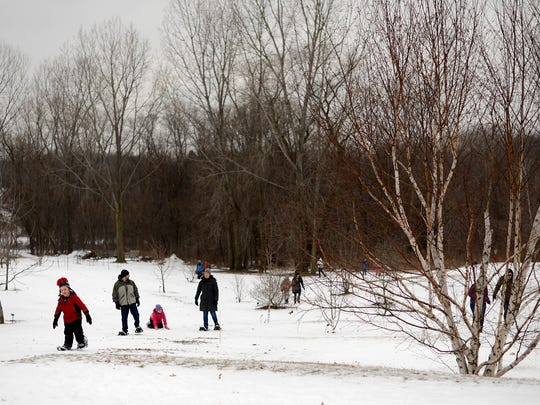 Festivalgoers try out snowshoes while attending the Winter Family Festival at the Green Bay Botanical Garden in Green Bay on Saturday.