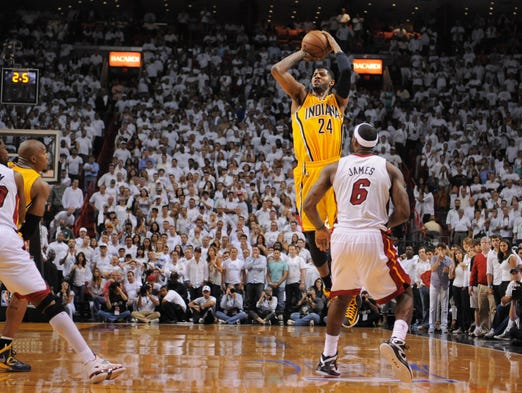 Pacers' Paul George shoots a 3-pointer over the Heat's LeBron James to tie the game as regulation time ends and send the Game One of the Eastern Conference Finals into overtime, May 22, 2013, at the American Airline Arena in Miami.