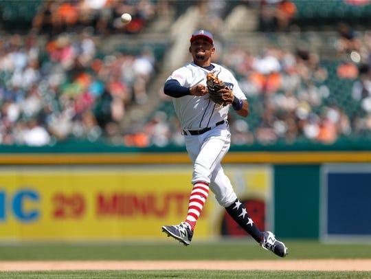 Tigers shortstop Dixon Machado (49) throws the ball