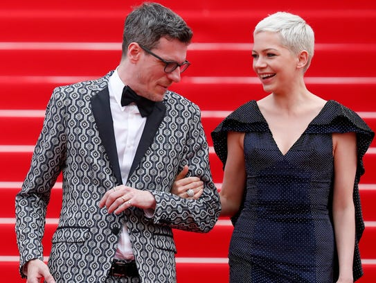 Author Brian Selznick and Michelle Williams leave the