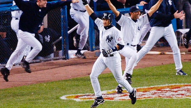 The Yankees' Aaron Boone celebrates after hitting a home run in the 11th inning to beat the Red Sox in Game 7 of the American League Championship Series in 2003.