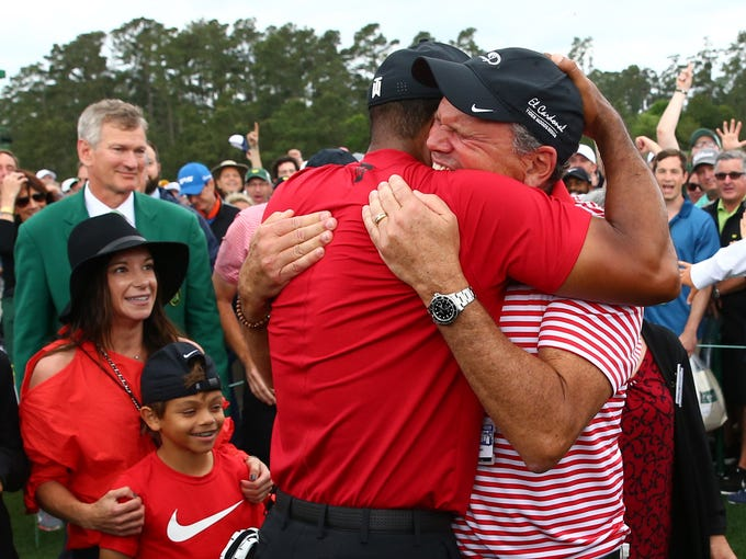 Apr 14, 2019; Augusta, GA, USA; Tiger Woods hugs Glenn