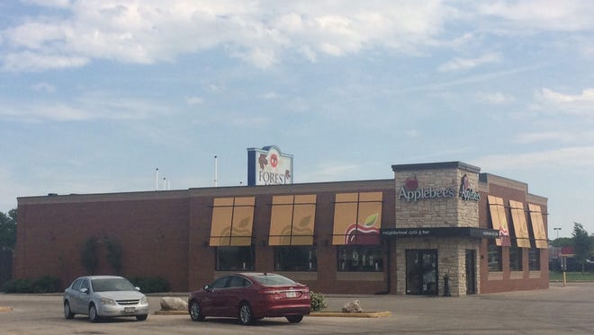 Applebee's Restaurant remains dark while police investigate a threat Thursday.