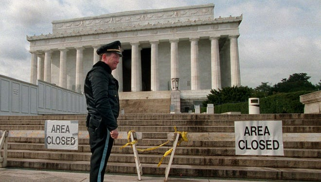 U.S. Park Service officer P.G. Carroll stands in front of closed signs at the Lincoln Memorial in Washington DC on  Nov. 15, 1995, during a shutdown of the federal government.