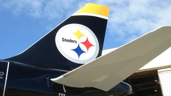 US Airways, which has since merger with American, unveiled this Airbus A319 with a Pittsburgh Steelers paint scheme in September 2007.
