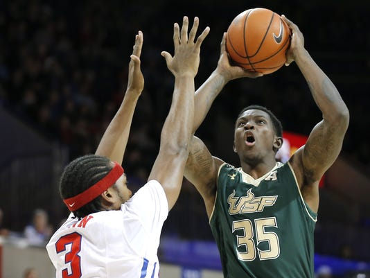 South Florida forward Bo Zeigler (35) attempts to shoot as SMU guard Sterling Brown (3) defends during the first half of an NCAA college basketball game Saturday, Jan. 2, 2016, in Dallas. (AP Photo/Brandon Wade)