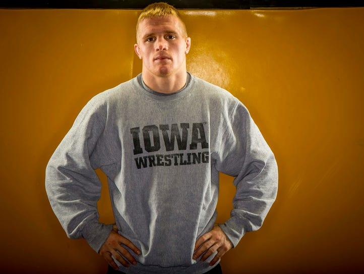 Phillip Laux, 133-pounder, poses for photos during