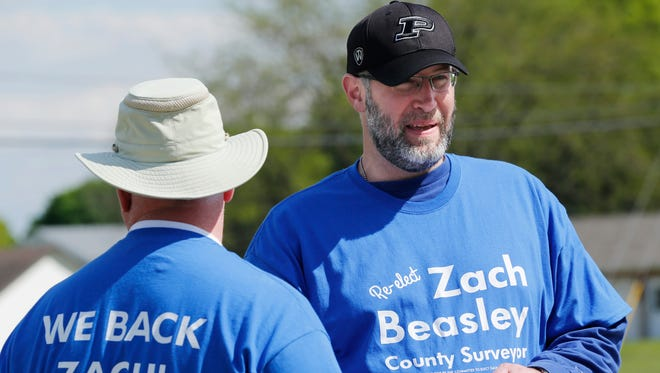 Incumbent Tippecanoe County Surveyor Zach Beasley and his campaign manager Tracy Brown greet voters at Lafayette Fire Department station No. 5 Tuesday, May 3, 2016, at Union Street and Creasy Lane in Lafayette. Beasley is being challenged by Michael Daugherty.