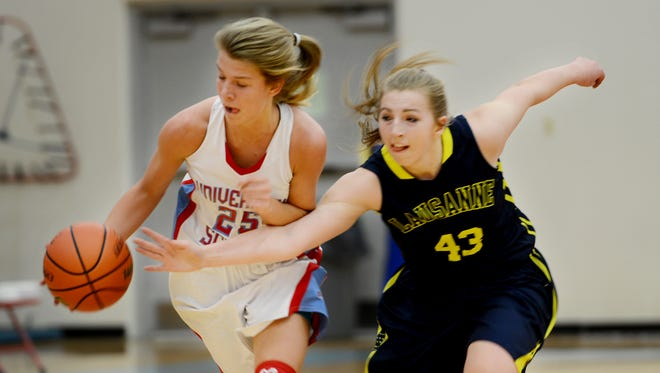 Lausanne Collegiate School's Sarah Edwards attempts to strip the ball from University School of Jackson's Anna Jones during their game Thursday.