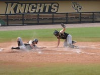 Junior Luke Hamblin slides past the attempted tag of Matt Diorio during UCF's first baseball practice of 2015 on Sept. 24, 2015.