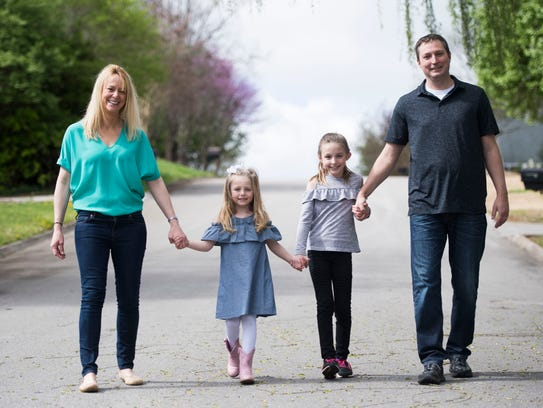 Amanda Nerstad stands with her husband, Gary, and their two daughters, Greta, 5, and Isabella, 8 near their West Knoxville home on Friday, March 30, 2017. Amanda is battling stage IV, non-small cell (nonsmoker's) lung cancer.