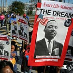 People march during the annual Martin Luther King Jr. Day celebration in Clearwater, Fla., on Jan. 19.