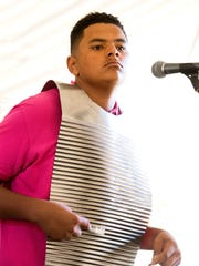 Zion Gennuso plays rubboard with Keith Frank and the Soileau Zydeco Band at the 2016 Festivals Acadiens et Creoles in Girard Park.