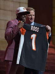 John Ross poses with commissioner Roger Goodell after being selected by the Cincinnati Bengals in the first round of the 2017 NFL Draft in Philadelphia.