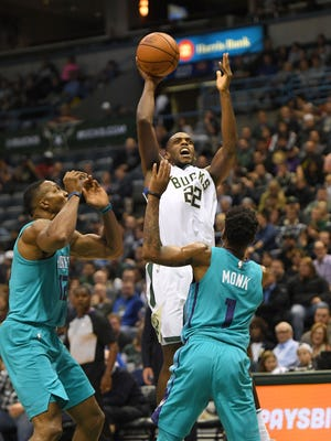 Khris Middleton of the Bucks goes up for a shot in front of the Hornets' Malik Monk during the first half on Monday night at the BMO Harris Bradley Center.
