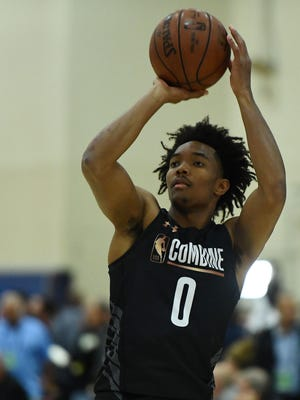 Devonte' Graham participates in drills during the NBA draft combine at Quest MultiSport Complex on Thursday in Chicago.