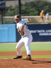 Southern Miss' Mason Strickland delivers to the plate