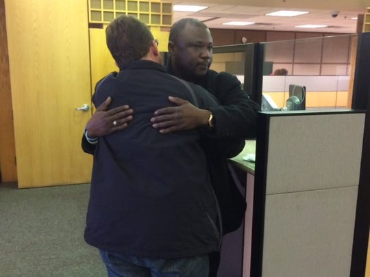 Abdul Marah of Des Moines was overcome with emotion when Jonnie Wright paid his $285.41 energy bill Tuesday in Des Moines.
