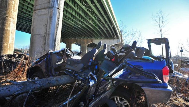 The SUV flew off the bridge and landed upright beneath the Hackensack River bridge, missing the river by about 40 feet.