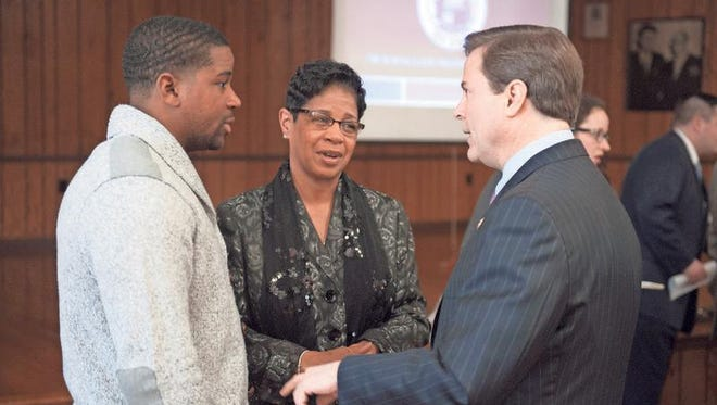 Pastor Dana Green (center) and her son Anwar Green speak with Congressman Donald Norcross following a press conference to announce a New Jersey Department of Labor & Workforce Development program aimed at training Camden residents. The program will be named after Pastor Green's late husband Ronald Green. Tuesday, February 17, 2015.