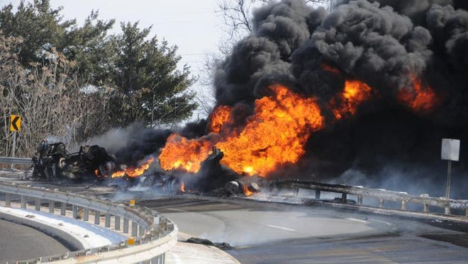 A tank truck rolled and caught fire on the ramp from the Betsy Ross Bridge to Rt. 130 in Pennsauken NJ on Monday morning. Numerous fire companies from Camden and Burlington counties responded.. The driver was reported to have escaped uninjured. Photo / Curt Hudson