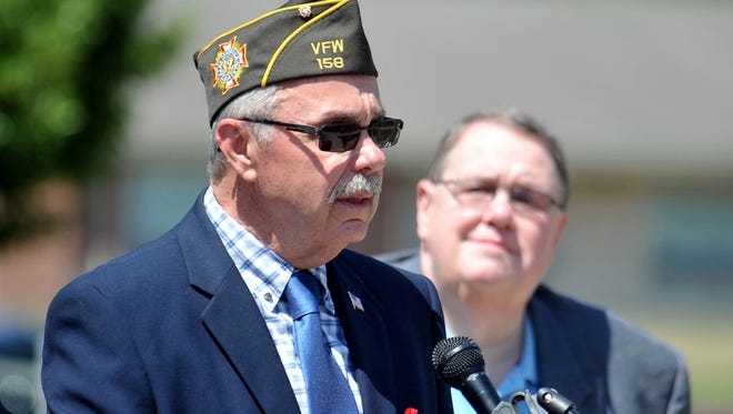 Township Committee member John Armato, chairman of the township's veterans advisory board, talks during the Memorial Day service at Buena Vista Township Municipal Hall in Buena Vista, Sunday, May 24, 2015.  Staff Photo/Sean M. Fitzgerald