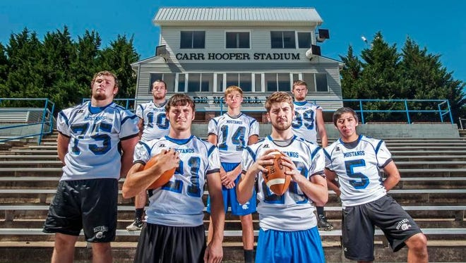 Smoky Mountain senior Chase Fisher (20) is the starting quarterback for the Mustangs. He is pictured here with  Zack Beck, Connor Moore, Carson Shuler, Jacob Gass, Nick Napert and Jayce Wolfe.