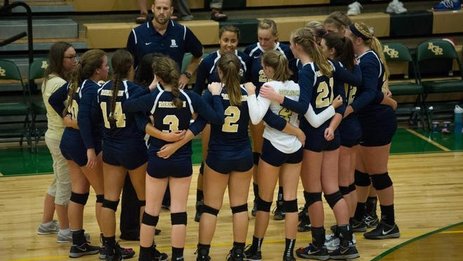 The Roberson volleyball team huddles up Tuesday at Reynolds.