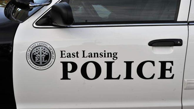 Police are looking for a suspect in connection with the armed robbery of an East Lansing hotel early this morning.