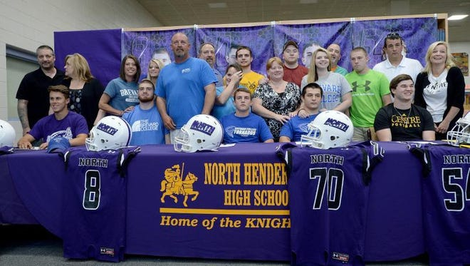 Five North Henderson seniors signed to play college football on Friday.